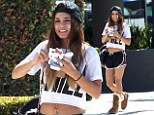 She's an '80s child! Vanessa Hudgens wears retro shorts, crop top and snapback to get an iced drink with her sister