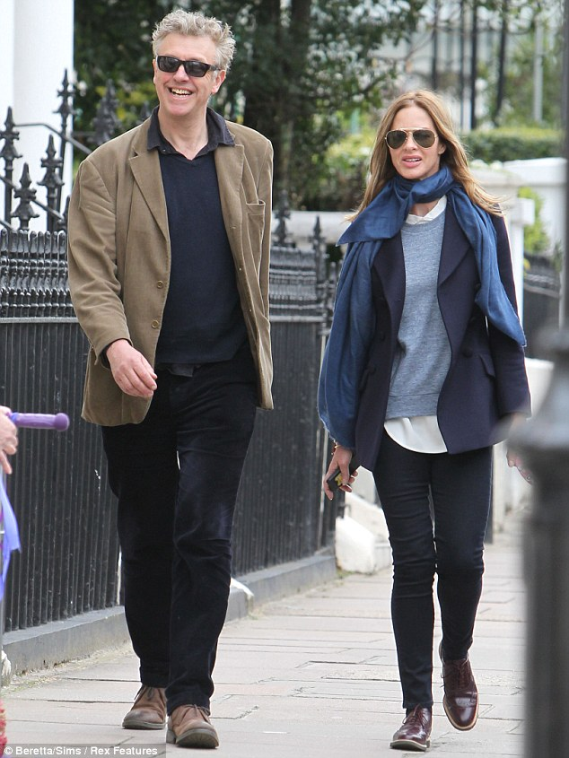 Another day, another pal: On Tuesday morning, Trinny was spotted out and about in London walking her dog with another mystery companion