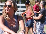 No love for LeAnn? Eddie Cibriani and Brandi Glanville goof around with sons at soccer game while the country singer sits on the sidelines