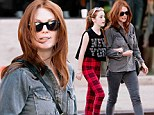 Twins! Julianne Moore and her daughter Liv displayed their striking similarities as they strolled through New York City's Meatpacking District on Saturday