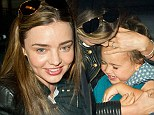 The sheer joy of it! Miranda Kerr and her toddler Flynn are reunited as she returns to New York after Paris Fashion Week