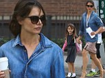 Sky high heels and matching accessories! Katie Holmes and Suri Cruise are a stylish pair as they dash to school in New York