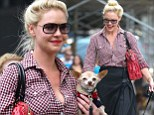 Yeehaw! Katherine Heigl vamps up her Western-style gingham shirt by unbuttoning it to display a hint of cleavage