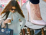 Exotic foot forward! Selena Gomez's henna tattoo spices up her sheer blouse and jeans on coffee run