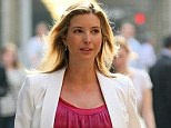 Blooming: Entrepreneur Ivanka Trump shows how to do maternity chic in a satin fuchsia dress with a white jacket - her due date is less than two weeks away