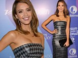 Jessica Alba is a shining star in a leather houndstooth dress that shows plenty of cleavage at Power Of Women event