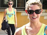 Ray of sunshine! Gym bunny Ashley Greene is cheerful in a bright yellow top after yet another workout