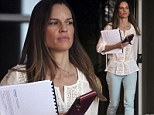You wouldn't want to mess with her! Tough girl Hilary Swank puts on her serious face as she gets down to business at the bank