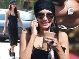 What this old thing? Newly engaged Naya Rivera shows off her massive diamond ring like it is no big deal as she grabs a coffee
