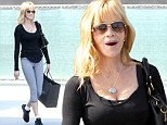 Working yoga-girl! Melanie Griffith shows off her toned pins in skin tight leggings as she enjoys a day of retail therapy
