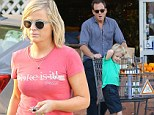Near miss! Amy Poehler arrives at a Beverly Hills supermarket just minutes after ex-husband Will Arnett leaves with their son