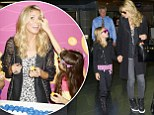 Piece of cake! Heidi Klum clowns around with young fans after arriving in New York with her lookalike daughter Leni