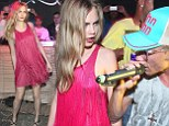 Cara Delevingne dominates the dancefloor in bright pink tasselled dress at Rio cocktail party