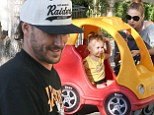 Wheel-y fun! Kevin Federline's two-year-old daughter Jordan whizzes around in a plastic car on family grocery shopping trip