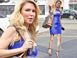 Brandi Glanville displays very slender figure in skintight dress while teetering in stilettos to film scene for Real Housewives