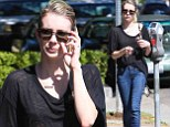 Chin up! Emma Roberts looks glum behind dark sunglasses as she strolls into a West Hollywood eatery