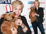 Why hi there! Jane Lynch shares a Glee-ful cuddle with a very patriot pup