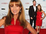 Jane Seymour looks radiant in red as she launches her new art exhibition... with handsome son Sean on her arm