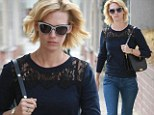 Mad Men star January Jones captures casual sixties chic in cat eye sunglasses
