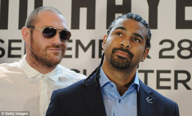 Got my eye on you: Tyson Fury has challenged David Haye to show up for their heavyweight clash in February