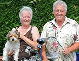 Above par: Barry and Barbara Shaw, with Hatchi, invest in funds