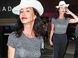 Her own personal catwalk! Former model Janice Dickinson confidently struts through LAX despite wearing a mismatched outfit