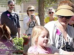 Getting into the Halloween spirit early! Amy Adams carves out some holiday fun at pumpkin patch with fiance and daughter