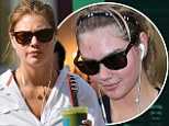 On a health kick? Kate Upton enjoys a nutritious green juice just days after revealing her spotty complexion