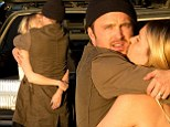 Don't leave! Aaron Paul was seen locking lips with his wife Lauren Parsekian as they arrived at Los Angeles International Airport on Saturday