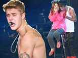 Justin Bieber shows off his tattooed torso in China as he strips off for his screaming fans