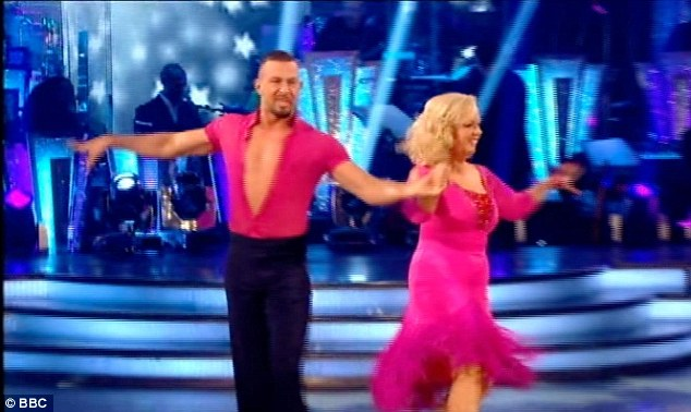 Pretty in pink: Next to take to the dancefloor was fierce Dragon's Den star Deborah Meaden and her partner Robin Windsor, who performed a cha cha to Aretha Franling classic Respect