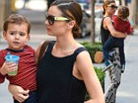 Always on her A-game! Miranda Kerr dons trendy butterfly-print trousers as she tends to adorable two-year-old son Flynn
