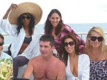 'We are NOT' a harem': Sinitta has opened up on the lavish holidays she shares with Simon Cowell and his loyal army of female friends (L-R) Lauren Silverman, Mezhgan Hussainy and Kelly Bergantz