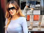 Cool cuffs: Sarah Jessica Parker rolled up her trousers once again as she stepped out in New York City on Thursday