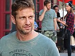 On the pull! Gerard Butler turns on the charm and flirts with a pretty brunette while out in New York