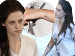 Real or fake? Kristen Stewart's latest arm artwork prompts speculation she's got more tattoos... though the dodgy handiwork suggests otherwise