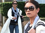 Catherine Zeta-Jones continues to wear her wedding ring while dressed down in jeans and a rain coat in New York