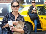 A real juggling act! A stylish Katie Holmes struggles to get out of a New York cab with a grab bag of goodies