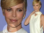 Charlize Theron attempts to hide an incision mark on her neck after it's revealed she had recent surgery to correct a broken vertebra