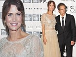 Need a new stylist? Kristin Wiig makes a curious fashion statement in unflattering lace frock as she joins Ben Stiller at film premiere