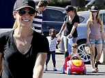 Jillian Michaels kept the sun out of her eyes with a black Laker's cap while shopping in Malibu Sunday with her family