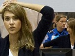 Not getting the star treatment! Jessica Alba doesn't look pleased as she is patted down by airport security
