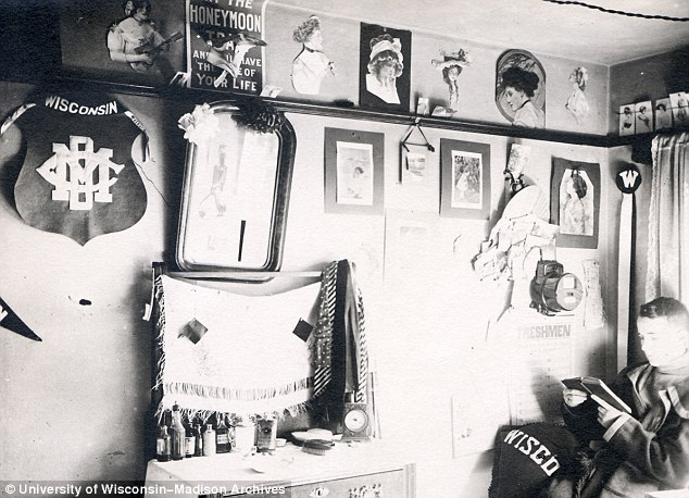 Big fan: A sports team flag can be seen prominently on this young student's wall
