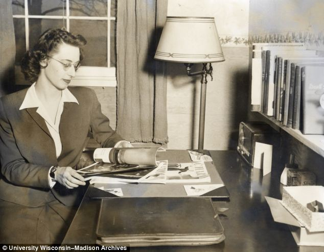 This married woman reads at her desk in the special accommodation reserved for families and married students