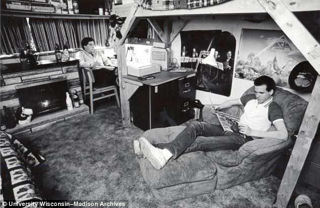 The boom times of the 1980s is portrayed in this picture where the students recline next to a fire place.