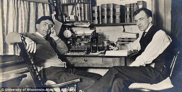 Suave: These male students pose in front of an old typewriter while one of them smokes a pipe in 1909