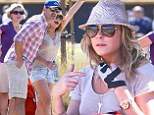 'Mason's team kicked butt!' LeAnn Rimes fights through the pain of a fractured hand to cheer on her stepson's soccer game