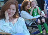 Mum mode! Makeup-free Marcia Cross is a radiant natural beauty at her twin daughters' soccer match