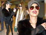 Members of Girls Aloud arrive at Heathrow Airport in London on a flight from Amsterdam.