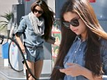 It's just good jeans! Selena Gomez displays her lean limbs in a denim playsuit as she pumps petrol